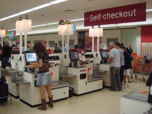 Self-checkout machines at supermarkets replace human workers